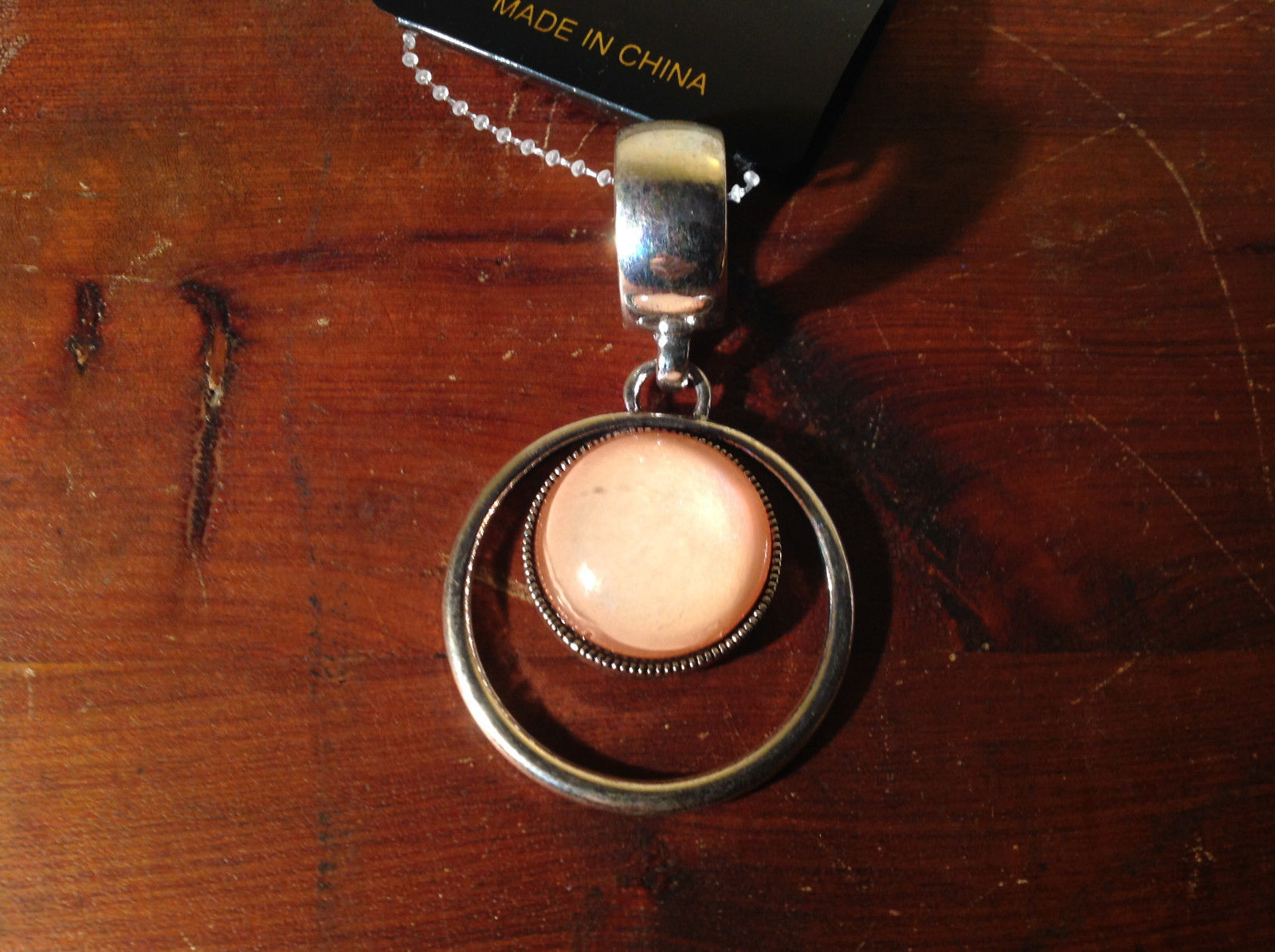 Striking Circular Silver Tone Scarf Pendant with Pinkish Stone by Magic Scarf