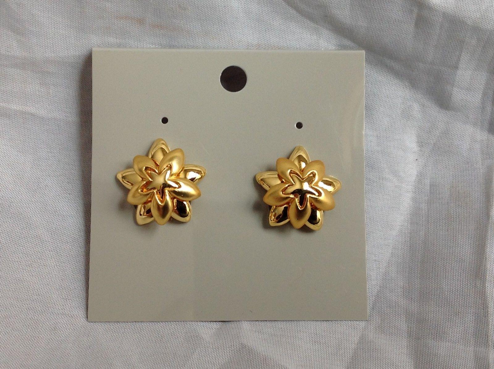 Swarovski Gold plated flower clip on earrings