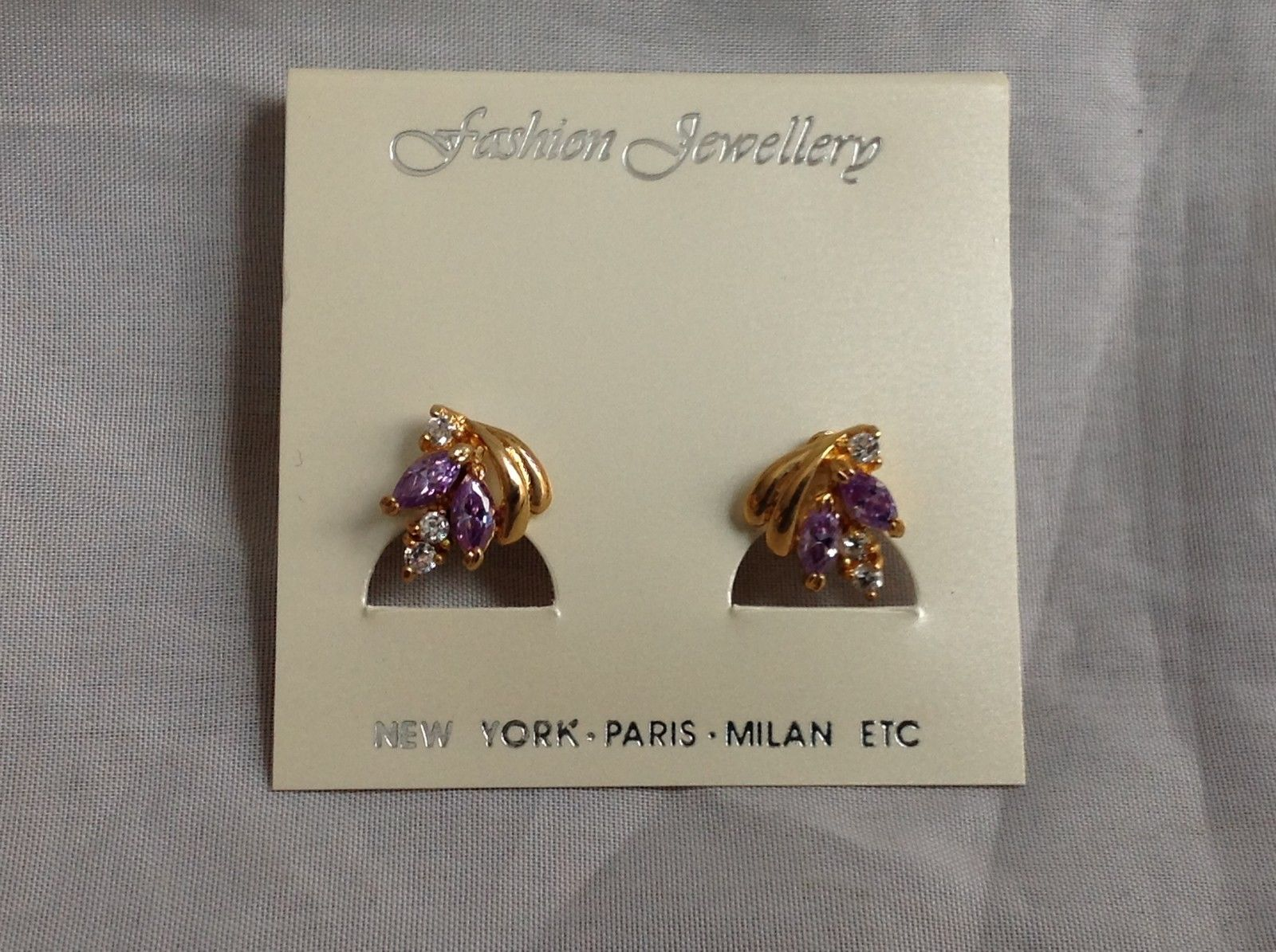 Swarovski Gold plated purple white stone stud earrings