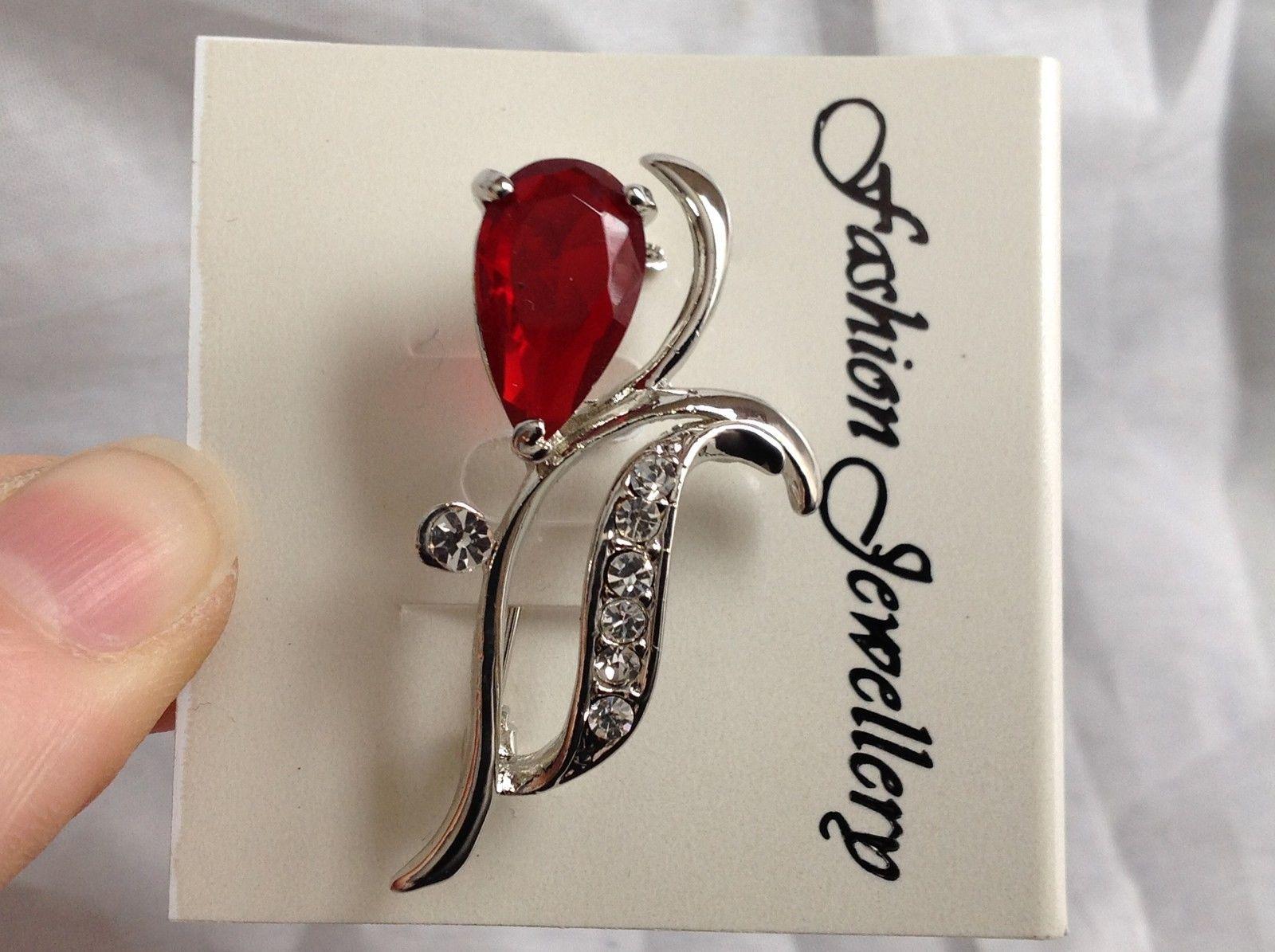 Swarovski  Silver tone red  flower stone brooch pin clear crystal leaf