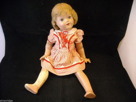 Antique doll in a dress image 3