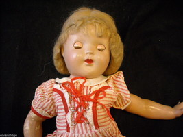 Antique doll in a dress image 5