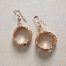 Rose Gold finished wire hoop restaurant image 2