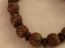 Tiger stripe on brown stretchy bracelet with wood spacers made in USA