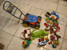 Toy Lawn Mower + misc. Toys