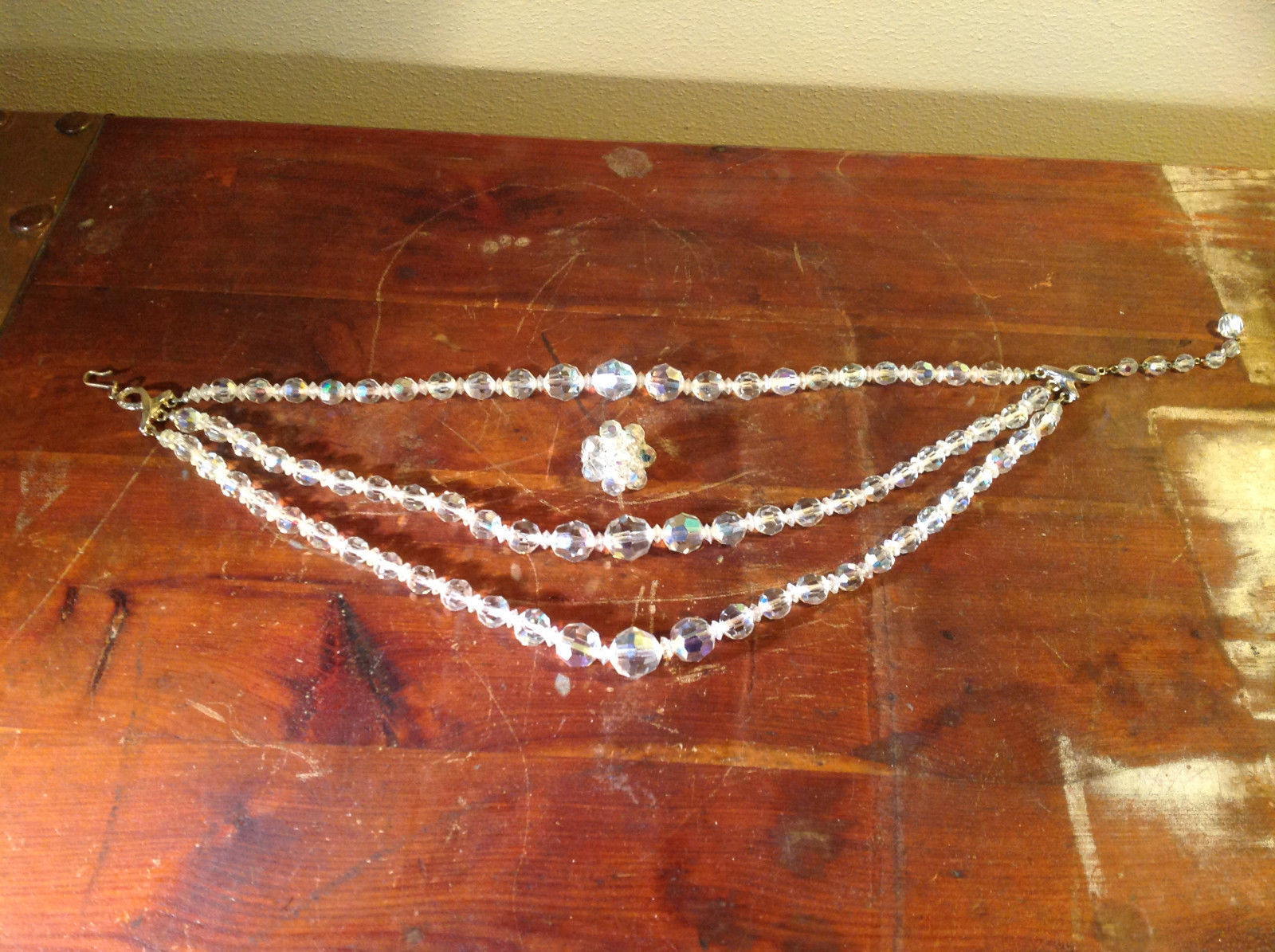 Two Piece Set including 3 Strand Necklace with Plastic Crystals and 1 Earring