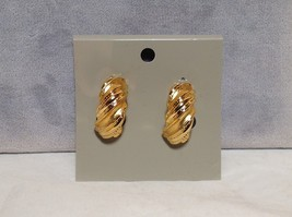 Twist Wave Design Gold Tone Clip On Earrings Clip on Area is Plastic Against Ear