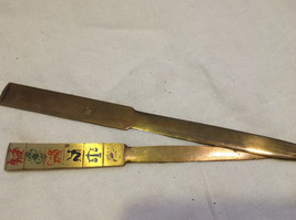 Two brass estate letter openers made Israel Italy one w Zodiac signs