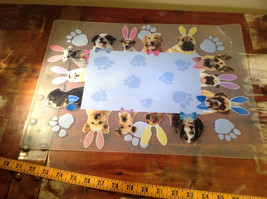 Very Cute Four Piece Set of Dog Themed Plastic Place Mats