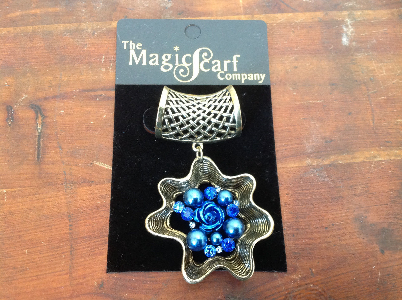 Very Light Gold Tone Finish Blue Crystals Flower Scarf Pendant by Magic Scarf