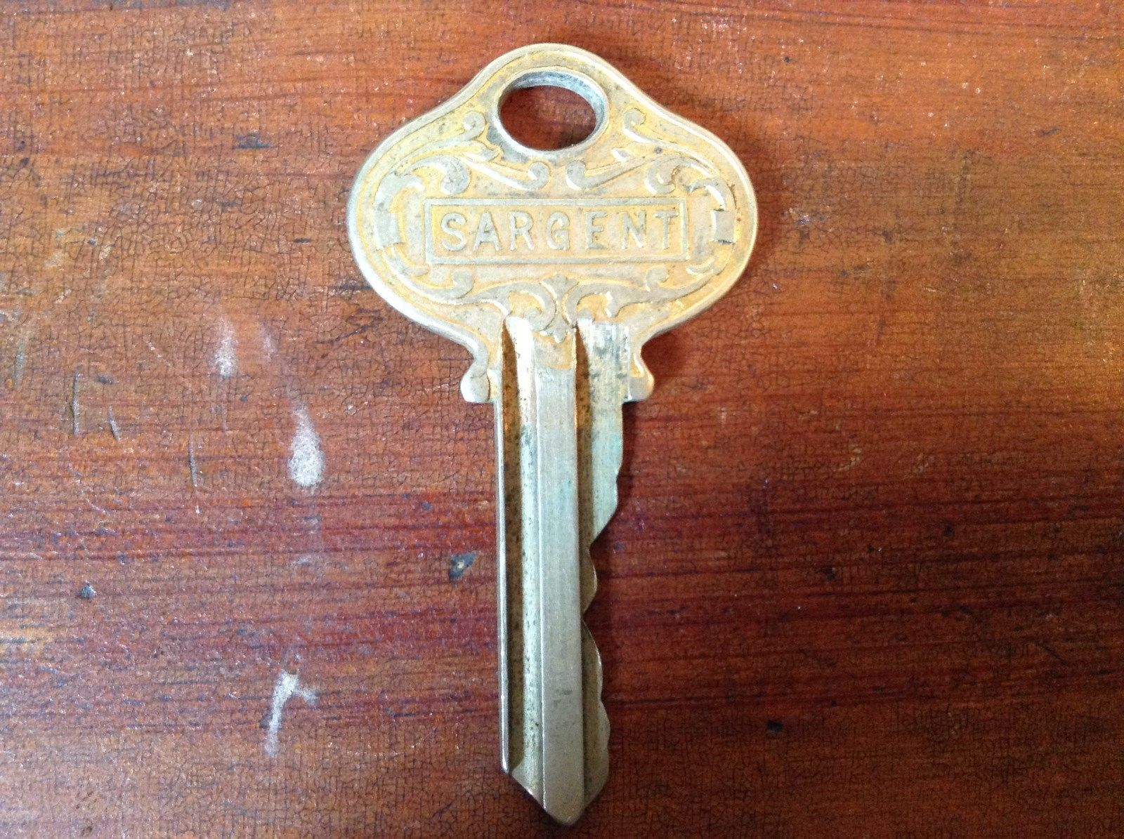 Vintage Gold Tone Sargent Key with Classic Designs