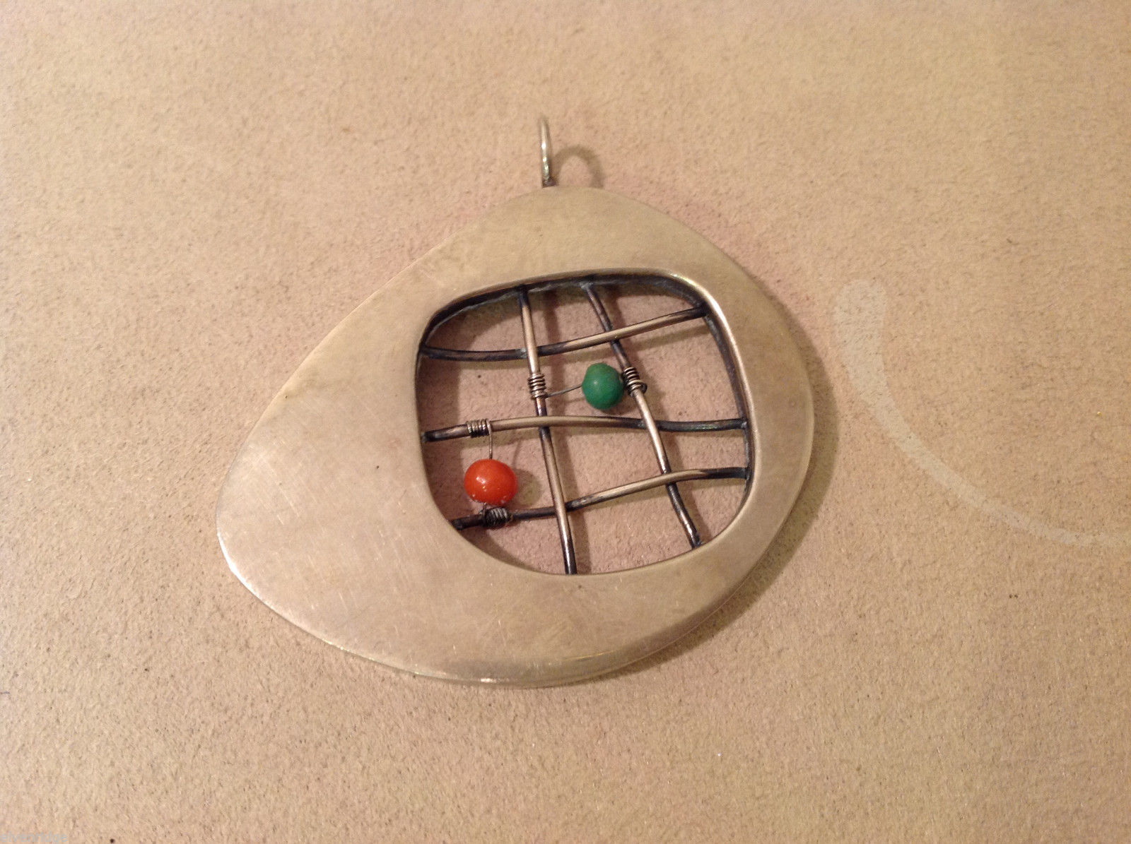 Vintage Handcrafted Silver Charm Pendant, green orange beads on criss cross wire