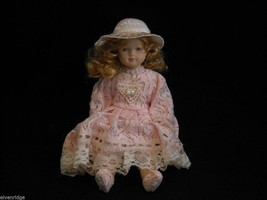 Vintage Porcelain Doll With Pink Outfit