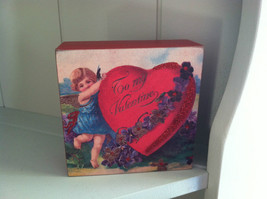 Vintage Red Wooden Box Sign - Cupid holding up a very large Valentine Heart