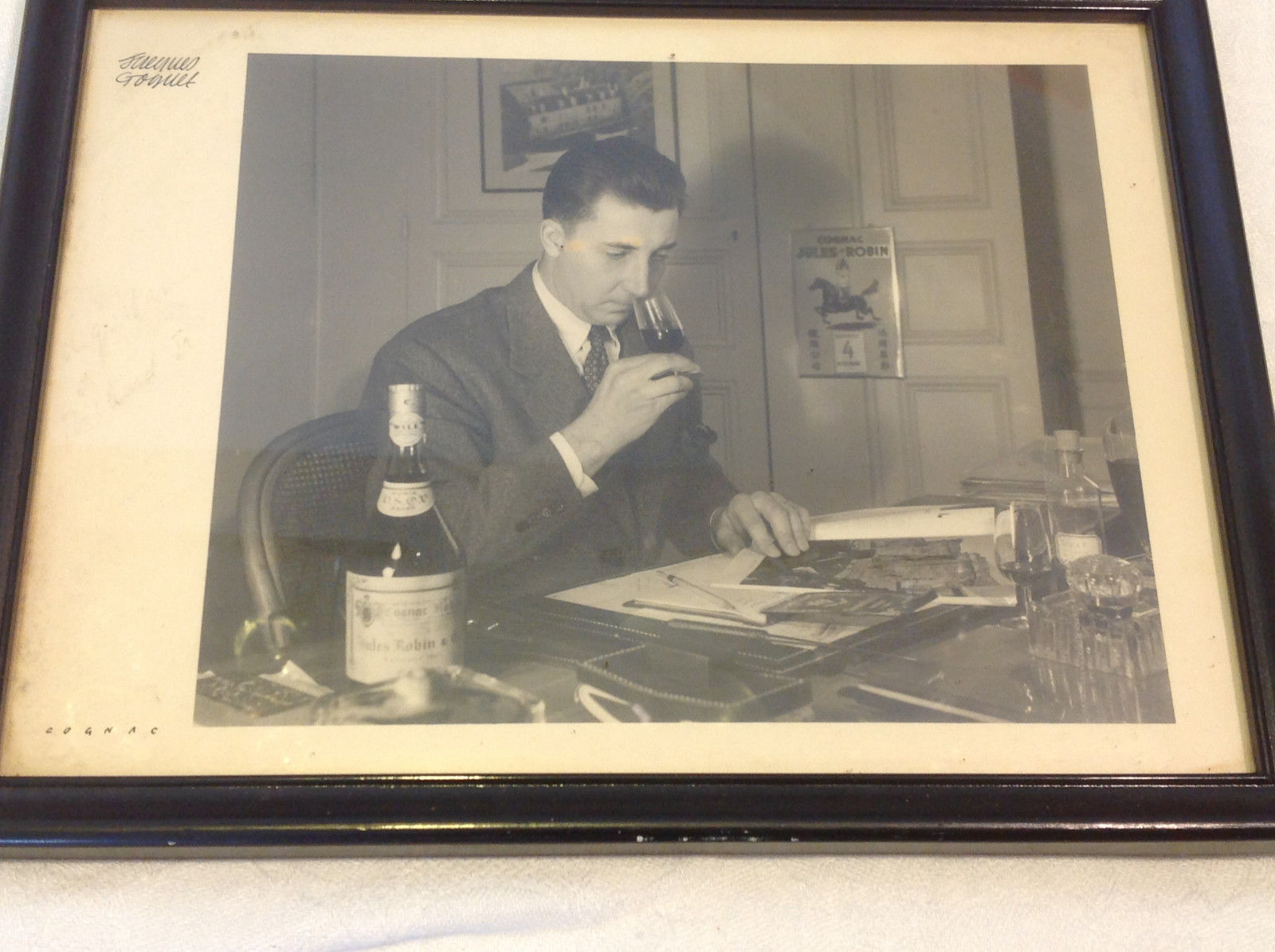 Vintage framed matted photograph of man tasting Jules Robin Cognac signed