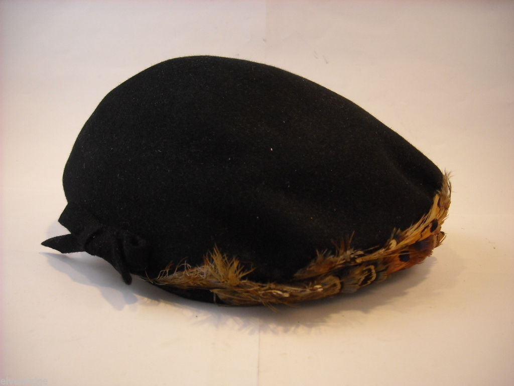 Vintage furry black hat with feather trim