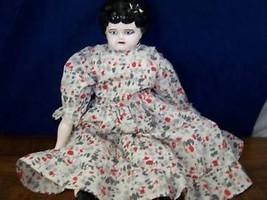 Vintage ceramic hand painted lady doll in spotted dress - $49.49