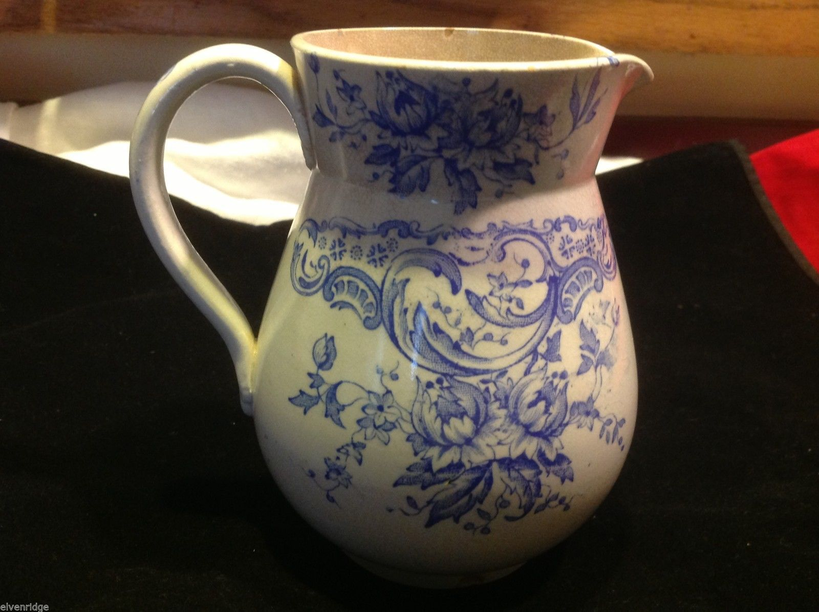Vintage delicate blue floral patter ceramic white European pitcher