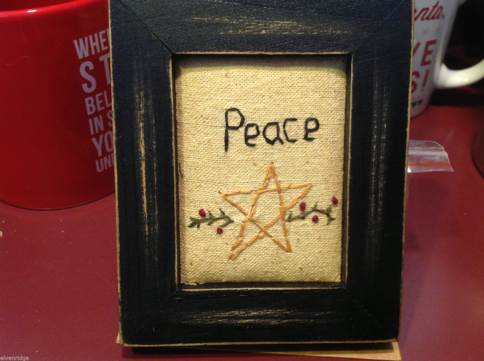 Vintage look framed fabric stitchery with PEACE and star