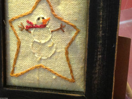 Vintage look framed fabric stitchery with snowman and star