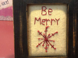 Vintage look framed fabric stitchery with snowflake and Be Merry