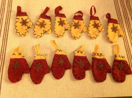 Vintage look red cream felt mini mittens set of 12 w rusty snowflakes stitching