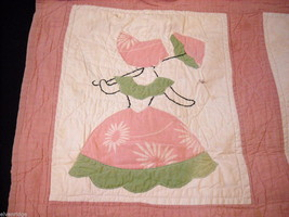Small crib quilt with girls in each frame image 3