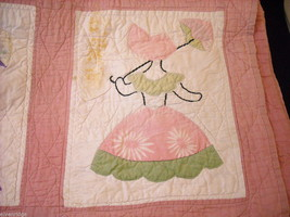 Small crib quilt with girls in each frame image 4