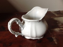 White Ceramic Creamer with Intricate Handle