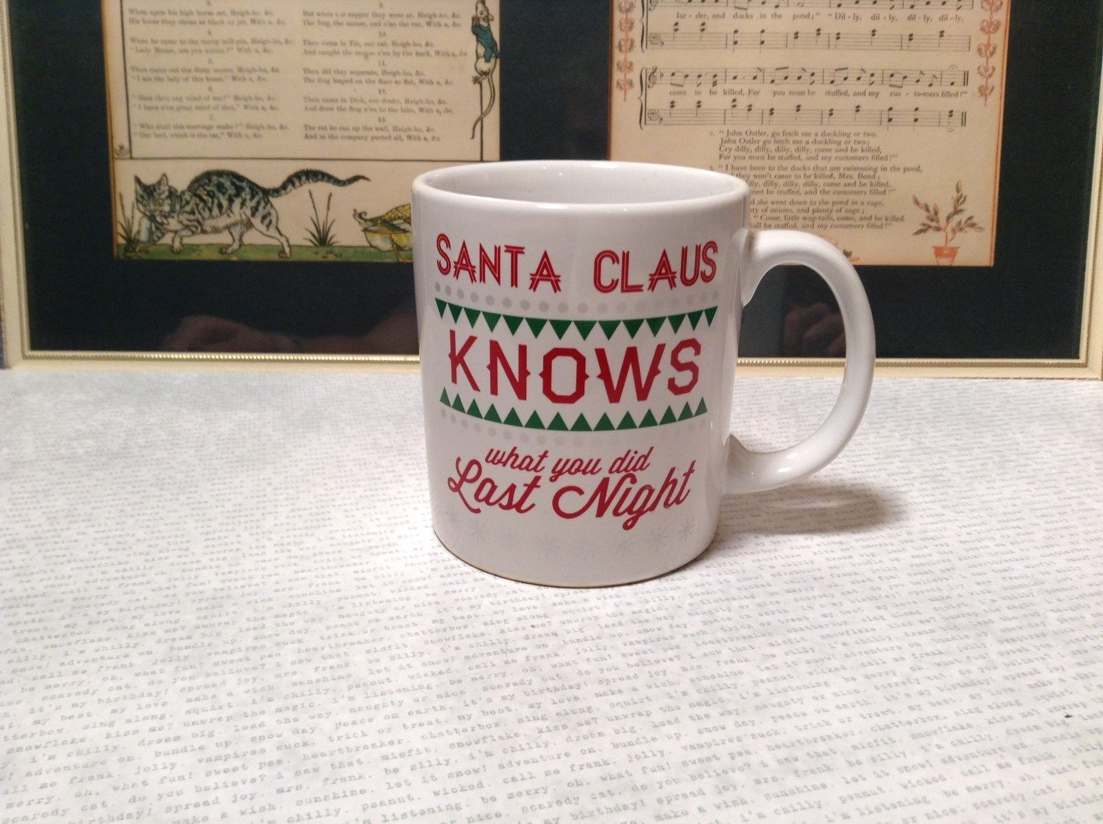 White Coffee Mug With Red Lettering Santa Claus Knows What You Did Last Night