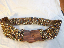 White brown blue beaded elastic belt wood closure that slips together to close