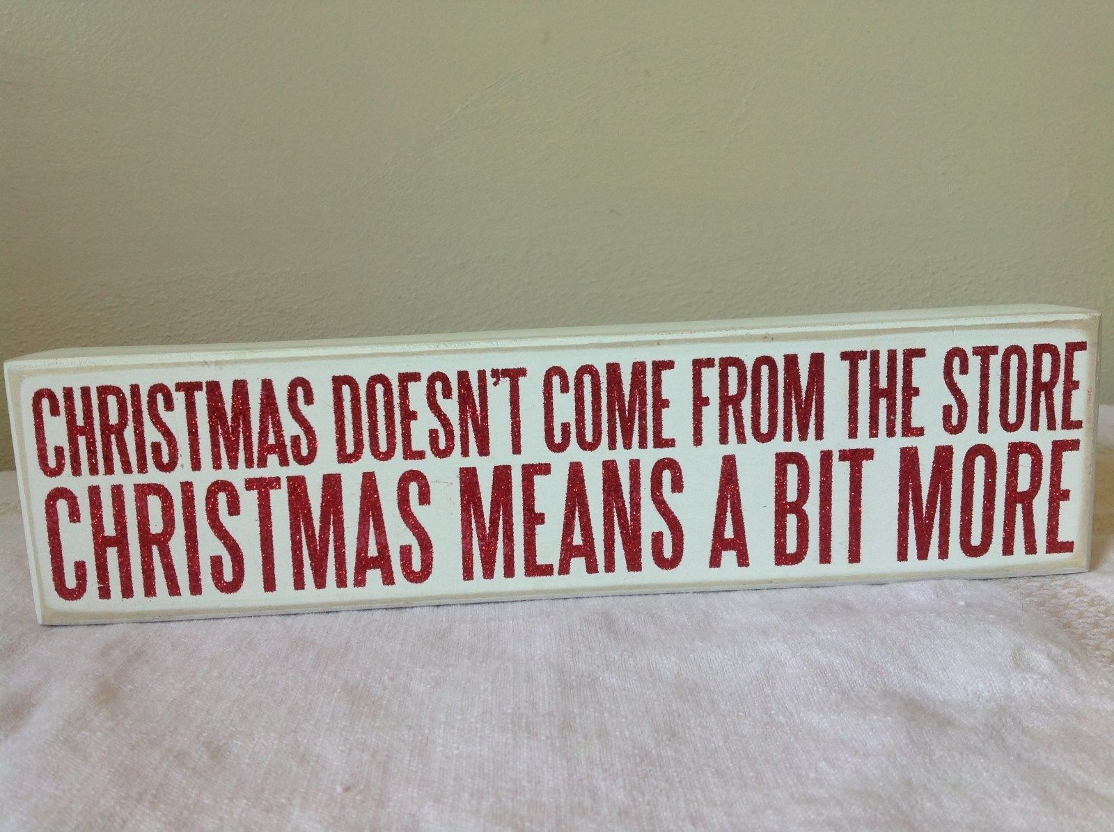 White with Red Letters Wooden Sign Christmas Doesn't Come From the Store