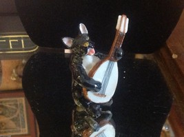 ceramic miniature dog black and white Bull Terrier playing the balalaika - $74.24