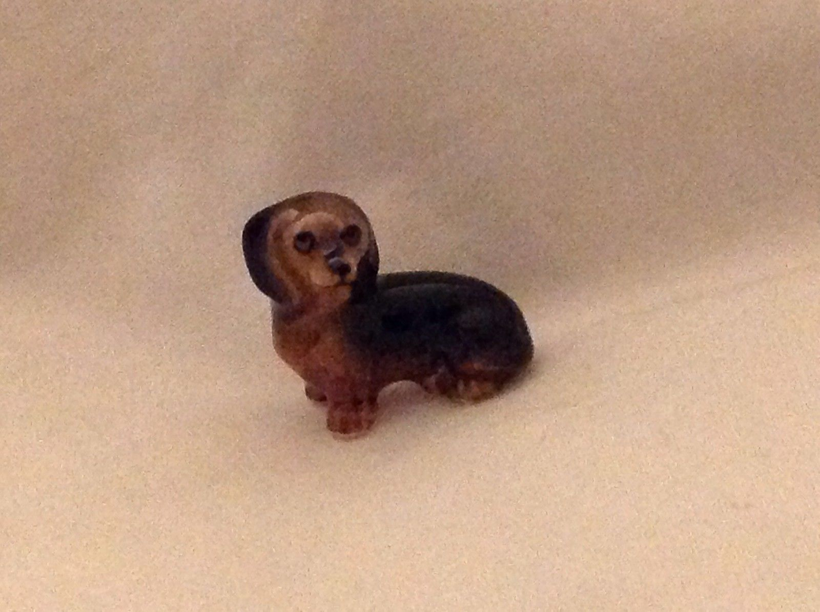ceramic miniature dog cute sitting down dachshund free second dachshund lying