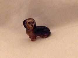 ceramic miniature dog cute sitting down dachshund free second dachshund lying