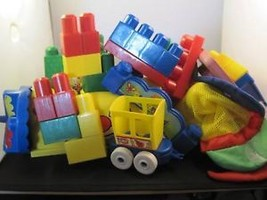collection of building blocks and baths toys