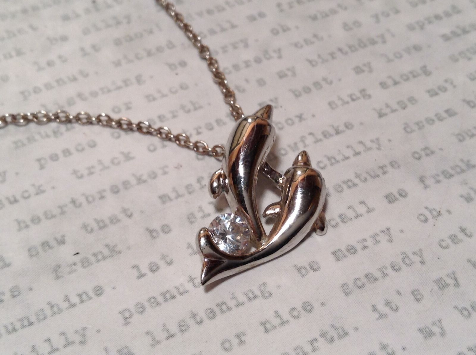 "dolphin couple necklace 10"" silver cz with white gold plating"
