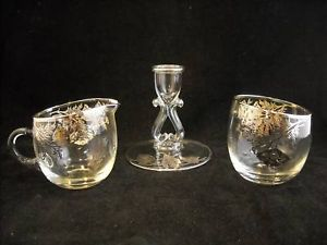 set of glass creamer,sugar and candle holder