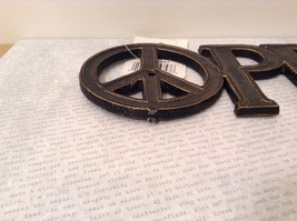 Black Metal Coat Rack with PEACE Signs on Each Side of Word PEACE image 3