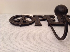 Black Metal Coat Rack with PEACE Signs on Each Side of Word PEACE image 2