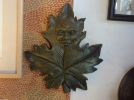 Brown  wall plaque plaster leaf with face image 4