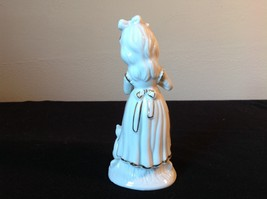 Ceramic Status of Girl White with Gold Covering Holding a Hat and Cat Sitting image 3