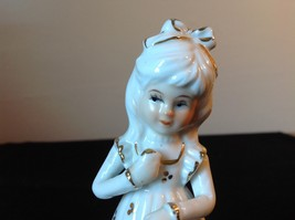 Ceramic Status of Girl White with Gold Covering Holding a Hat and Cat Sitting image 5