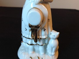 Ceramic Status of Girl White with Gold Covering Holding a Hat and Cat Sitting image 6