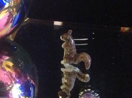 Ceramic miniature brown squirrel standing upright in curiosity image 2
