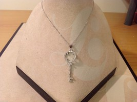 Charming delicate crystal key necklace with silver tone chain bail image 2