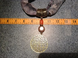 Circular Gold Tone Scarf Pendant with Flowery Design Looks like Polished Stone image 3