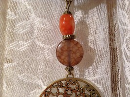 Circular Gold Tone Scarf Pendant with Flowery Design Looks like Polished Stone image 6