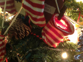 Five red white striped knitted stockings on washline with rusty clothespins image 7