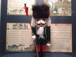 Green Russian Hat Wearing Nutcracker with Flag in Hand Ten and Half Inches Tall image 3